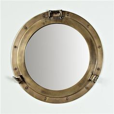 "Nautical Brass Porthole Mirror  Bring vintage nautical style to your bath with this porthole mirror in beautiful antique brass. The perfect size for a powder room or guest bath.   (20.25""Hx20.25""Wx1""D)   Diameter of inner mirror (14.5"")   Product SKU: MW10026 BZ  Price:  $249.00"