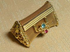 Vintage Pill Box Gold Chain Purse Rhinestones Ornate Gold Beautiful. $36.00, via Etsy.