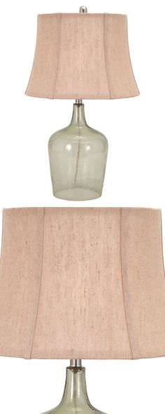 Look what the tide brought in. Set on a textured clear glass base, this Message in a Bottle Table Lamp is truly a timeless treasure. Topped with a tapered heathered beige shade, this gorgeous fixture i...  Find the Message in a Bottle Table Lamp, as seen in the #SoftSideofMidCentury Collection at http://dotandbo.com/collections/soft-side-of-mcm?utm_source=pinterest&utm_medium=organic&db_sku=121429