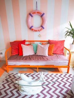 pink sofa dolphin coffee table colourful home colourful house tour