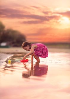 """Little girl playing with boats on a lake at sunset.... <a href=""""https://www.facebook.com/pages/Broquart-Photography/374405426079137?ref=aymt_homepage_panel/"""" target=""""_balnk""""> 