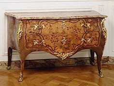 Stunning commode designed by Pierre Flechy for the Chateau de Versailles.  The marquetry is delicate and lovely, isn't it?  Discover more about 18th Century France at leahmariebrownhistoricals.blogspot.com