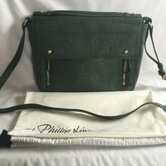 """Brand New 3.1 Philip Lim Jade Pashli Messenger bag 3.1 Philip Lim Pashli Jade Messenger bag. Brand New! Never been used. Comes with dust bag. Can be worn as a shoulder bag, carried with top handle or as a crossbody bag. Measurements: 9.5"""" x 12.5"""" x 3"""" x 29"""" max strap drop *PRICE IS NOW FIRM* 3.1 Phillip Lim Bags"""
