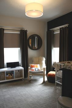 "Bright and colorful rooms are great for babies, but sometimes, I lament the fact that once you design an awesome nursery, it's stuck as a nursery forever.  The black curtains and gray carpet in this nursery are fresh and unique and can withstand the change from nursery to ""other"" room in a jiff."