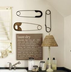 Picture is originally from a 'Ballard Designs' catalog~~~~ the laundry sign is an easy to do knock-off, but the 'safety pins' would take some effort.   {Update...'safety pins' are on sale for $35.00 + S/H and I just ordered a set!....search 'Ballard Designs' go to sale~~~hurry ladies  :)