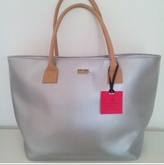 Valentine Jet Set Tote! This stylish piece can carry all you need for day out and complement your Chic evening look from day to night! Leather handless, high fashion interior and luxury finishes!!!