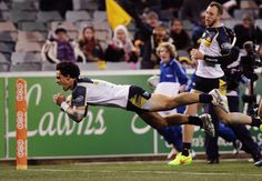 Matt Toomua of the Brumbies scores a try during the round 19 Super Rugby match between the Brumbies and the Force at Canberra Stadium on July 11, 2014 in Canberra, Australia.