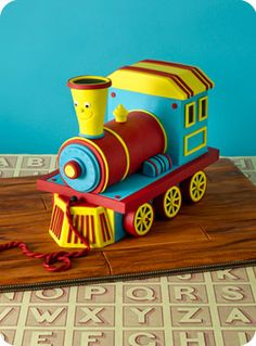 Confetti Cakes: Hand Sculpted Cakes -- Little Engine That Could-esque train cake