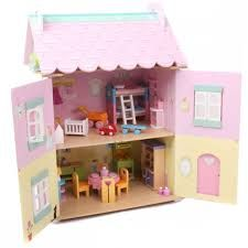 Sophie's House by Le Toy Van. An eternal classic from Le Toy Van. Fully painted in fresh white and rose pink, this large 3 storey dolls' house features a sparkly Wooden Dollhouse, Wooden Dolls, Dollhouse Furniture, Selling Furniture, Furniture Sets, Toddler Toys, Toddler Bed, Kids Toys, Open Shutters