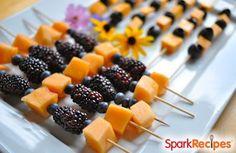 Healthy Halloween Party Food: Orange and Black Fruit Kebabs! Fun finger foods! | via @SparkPeople #recipe #fall #autumn #kid #school #treat
