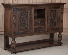 Antique vintage Renaissance raised buffet, forged iron strap hinges, finely carved doors, urn pediments, old growth European white oak
