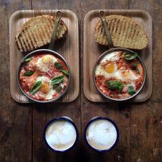 Baked eggs, avocado, smoky paprika, toasted sourdough, caffè latte. Symmetry Breakfast