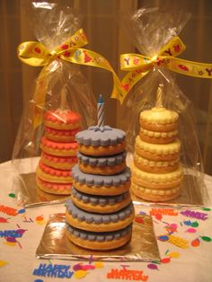 Basic sugar cookies become cool favors when stacked to resemble miniature cakes and topped with sugar flowers. Small dabs of royal icing secures each layer, holding the tower intact but still allowing the cookies to be pulled apart easily.