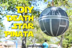 Star Wars Party Ideas - This death star piñata will make an amazing addition to your star wars themed party and the kids will have so much fun. This is made with paper mache, filled with treats and painted to look like the death star.