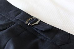 Side tabs make allow the gent to adjust the fit of the waist band without visually altering the trouser