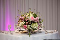 Low #centerpiece of #blush and #white flowers; including hydrangea, roses, Spanish lavender and hanging amaranthus