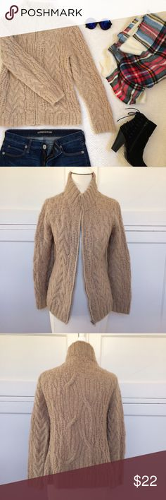 """Cozy Tan Zip-up Sweater NO TRADES. OFFERS WELCOME. PLEASE USE THE OFFER BUTTON. I DO NOT NEGOTIATE PRICE IN THE COMMENTS. Very cozy tan sweater from Forever 21. High collar. Zips up front. Unlined. 45% nylon, 55% acrylic. Has some stretch. In excellent pre-loved condition. 23"""" long. 17"""" across at bustline. Sleeves are 24"""" long. Forever 21 Sweaters"""