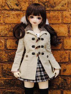 Boneca no casaco