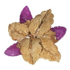 Bi-colored Gold and Ruby Flower Brooch, by Buccellati Designed as a textured yellow and rose gold foliate brooch, with three carved ruby flower heads Size: 42 x 42 mm Weight: 21 gr Signed M. Buccellati
