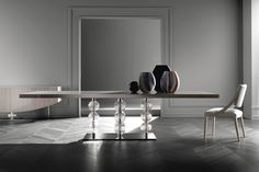 The Royal Dining Table from Pietro Constantini. This table represents some of the finer things Italian design has to offer. Polished steel base mixed with real murano glass accents, this piece represents  some of the finer stylings that Constantini and italy have to offer.