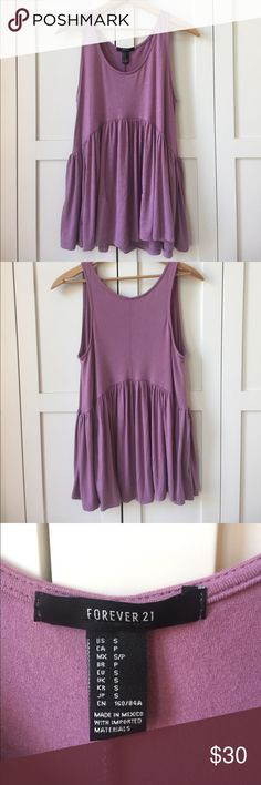 Forever 21 Purple Peplum Tank Top This is a beautiful tank top, very soft fabric. Goes well with a jean jacket, can be dressed up or down! Let me know if you have any questions😊 Forever 21 Tops Tank Tops