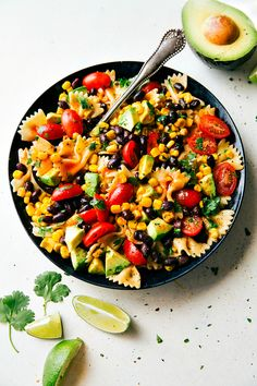 A delicious and super simple mayo-free Tex Mex Pasta Salad with corn, black beans, cherry tomatoes, and avocados. An easy Catalina dressing tops this salad.