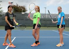 The Ames trio of Judith Fan, Elise Hill and Elizabeth Nutty will compete in the Class 2A girls' state tennis tournament over the next two days. Photo by Nirmalendu Majumdar/Ames Tribune