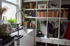 utility storage  eclectic entry by Colleen Steixner