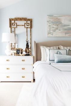 Calming Master Bedroom | Campaign Chests | Monogrammed Bedding | Abstract Art | Bamboo Mirrors | Lucite Curtain Rods http://www.styleyoursenses.com