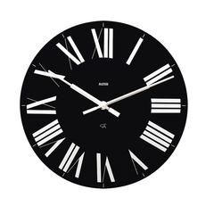 """Firenze. Designed by the Castiglioni brothers in 1965 for the Florence exhibition """"La casa abitata"""" at Palazzo Strozzi, the Firenze wall clock became part of the Alessi catalogue in 1996. It is now presented in two new tones that draw on the original colours used: a black face with white hands, and a white face with red hands."""