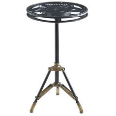 Designed just for media rooms and movie buffs, our handcrafted metal table features a vintage-style tripod base and film reel surface with a durable tempered glass top. An accent, yes. But one that's interesting enough to be the main attraction.
