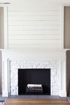 Clean white custom milled fireplace surround with shiplap and stone diy fake fireplace facades faux mantel makeovers solutioingenieria Images