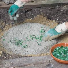 Step 4 Press recycled glass bits, shells, or other objects into the still-soft concrete for a decorative surface.