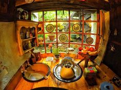 If you've ever wondered what it's like to live like a Hobbit, one man has an answer. He built a real Hobbit house in Scotland—and loves visitors. Tolkien, Hobbit House Interior, Casa Dos Hobbits, Roof Design, House Design, Sink Design, Wooden Toilet Seats, Wooden Beams Ceiling, Magical Home