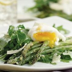 Asparagus Salad Topped with Poached Eggs  This asparagus salad topped with poached eggs is satisfying yet light, making it a nice option for lunch, brunch or even dinner with some crusty bread.  @eatingwell #spring