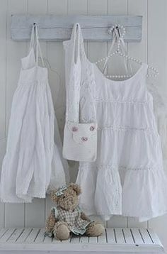 For a little girls bedroom or baby girl's nursery:a painted white piece of wood  with hooks turns into a pretty place to hang white dresses & a childs purse. So sweet