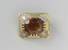 Brooch of gold, decorated with triangles in light blue enamel and a topaz, Louis Willem van Kooten (II), ca 1908 - ca 1911