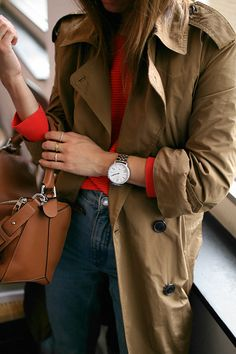 Nisi is wearing: Mango Trenchcoat, Red jumper, Denim mom jeans, Loewe Puzzle bag - teetharejade.com