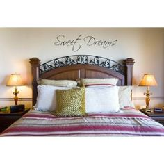 Sweet Dreams wall decal, solid headboard and matching lamps & nightstands, splendid feng shui for master bedroom living and home staging, signaling that this home supports equal partnership and is a happy couple's sanctuary
