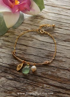 This bracelet features a beautiful briolette bead, ivory freshwater pearl and mini leaf charm hand stamped with the letter of your choice. Perfect for wedding jewelry, bridal jewelry and personalized jewelry. www.foxandfigs.etsy.com - $26