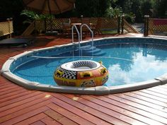 Above ground pool with wooden deck