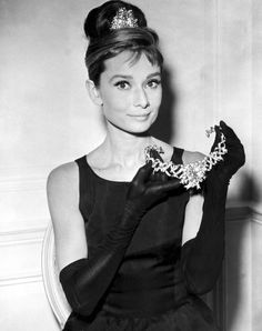 """"""" Audrey Hepburn modeling Tiffany   Co. s canary yellow diamond necklace  for the 1961 film Breakfast at Tiffany s. 882ee838a2"""
