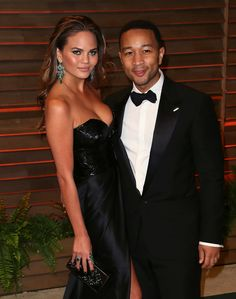 John Legend posed with Chrissy Teigen at the Vanity Fair Oscars party.