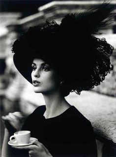 by William Klein, 1962 Tea Time, a lady who knows a fine afternoon will surely include a good hat and, of course, a good cup of tea.