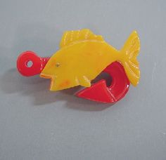 Shultz Bakelite yellow and red fish & hook brooch.