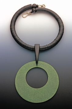 Sharon Rosenthal Design - laminated disc/wood/neck band of recycled vinyl record material-africa