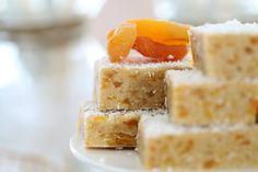 Our classic Apricot Coconut Slice is completely no-bake and takes just a couple of minutes to prepare! Apricot Slice, Easy Desserts, Dessert Recipes, Coconut Slice, Healthy Bars, Good Food, Yummy Food, Indian Sweets, Christmas Cooking