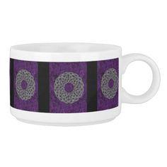 Silver celtic knot round pattern on purple.