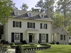 White colonial 'Father of the Bride' house with curved walk to front door.  mjv