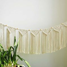 Did I mention that I'm totally into garlands right now? Because of those little wooden balls this one will look super cool in nursery or kids room. I imagine it below the book shelf or above the crib...  #macramegarland #macramebanner #nurserydecor #kidsroom #cribdecor #macrameartist #macrame #macramewallhanging #macramewalldecor #bohodecor #bohodreams #makersmovement #like4like #etsy #etsyshop #babyshowergift #scandi #scandinaviandesign #nordicinspiration #bunny #creativityfound #fibr...